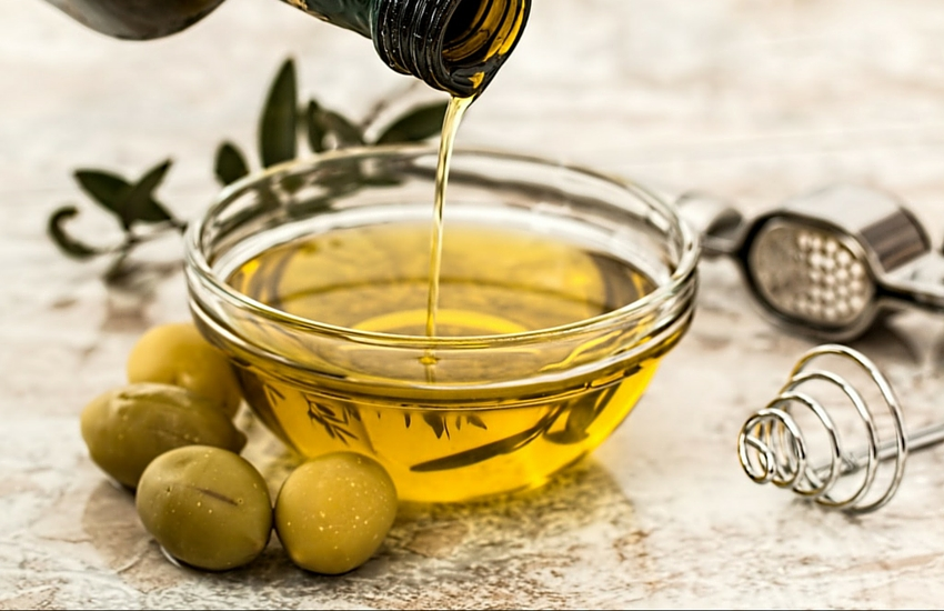 olive oil for hair in a bowl