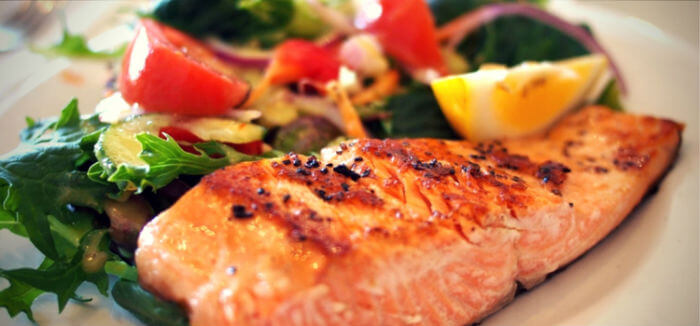 cooked salmon with side salad